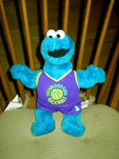 Sesame Street Cookie Monster plush doll sport outfit on
