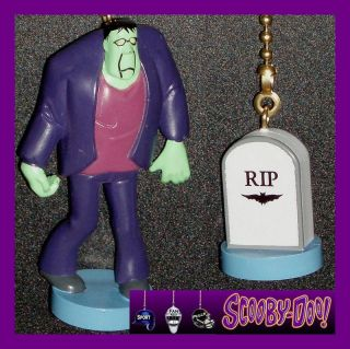 SCOOBY DOO MONSTER FIGURE & RIP TOMBSTONE FAN PULLS