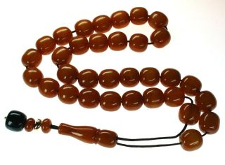 RARE PRAYER BEADS   KOMBOLOI. AMBER COLOURED FATURAN BEADS