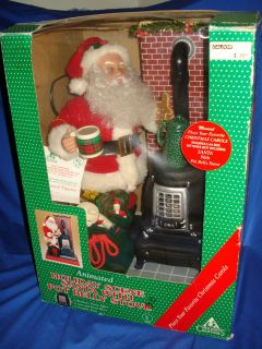 1994 ANIMATED MUSICAL LIGHT UP CHRISTMAS SANTA WITH POT BELLY STOVE