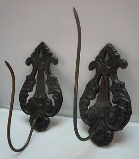 pair of antique black cast iron wall paper receipt spikes