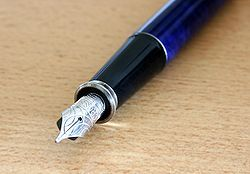An A.T. Cross fountain pen, with the distinctive Cross lettering on