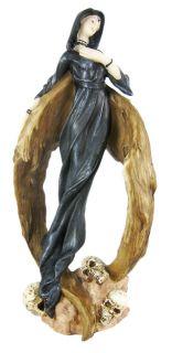 gothic dark angel in graveyard statue figure