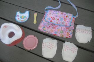 Baby Alive Accessories  diapers w/diaper bag,potty chair,feeding dish