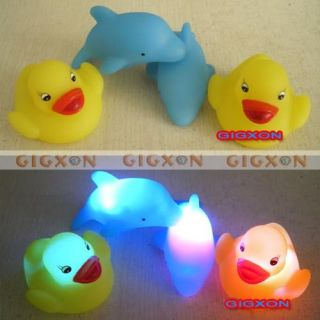 Baby Bath Fun LED Flashing Duck Dolphin Toy Rubber Light It Up Touch