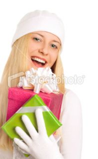 Happy girl holding gifts Royalty Free Stock Photo