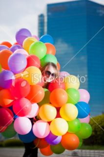 stock photo 12742561 woman holding many balloons