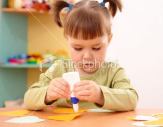 Little girl doing arts and crafts in preschool Royalty Free Stock