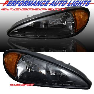 99 05 PONTIAC GRAND AM BLACK HOUSING HEADLIGHTS PAIR BRAND NEW