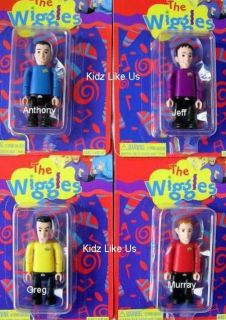 Set 4 of the Wiggles Figures & Big Red Car with the retired Greg