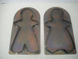 large copper gingerbread boy and girl cookie cutters