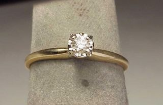 from 14k two tone gold with an approx 15 ct h si2 diamond set up