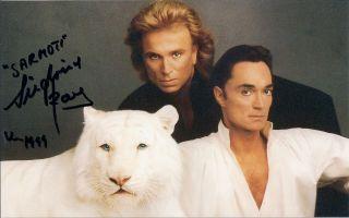 Siegfried Roy Autographed 5x8 color postcard 1999