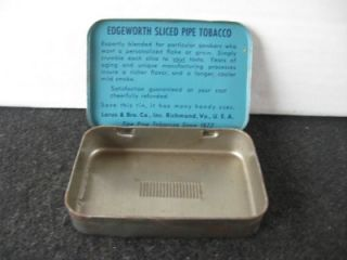 This tin is a vintage edgeworth tobacco tin. It is blue with black