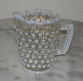 tiny pitcher or creamer in a pattern called elson dew drop made by the