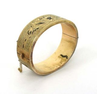 is a victorian 14k gold and enamel floral bangle bracelet the piece