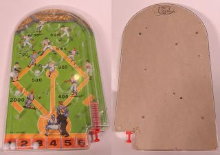 This is a vintage 1960s baseball pinball hand held game. It made of