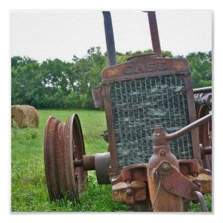This rusty antique Case tractor is sitting in one of our fields by our
