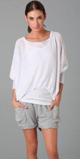 RLX Ralph Lauren Long Sleeve Slit Neck Top