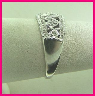 gold round diamond 3 heart band ring 22 carats total