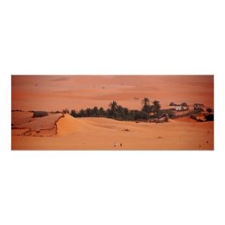 panoramic photo of desert dunes and oasis village in the Sahara Desert