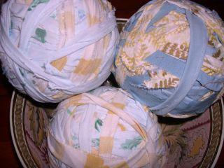 RAG BALLS, 5 1/2Dia MAKE RUGS. THREE PASTEL BLUE,WHITE, YELLOW, WEAVE