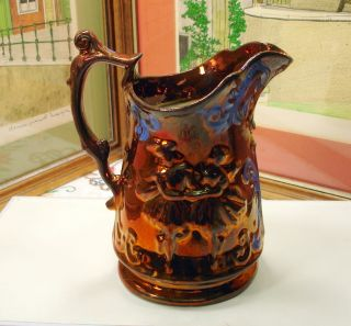 antique copper water pitcher