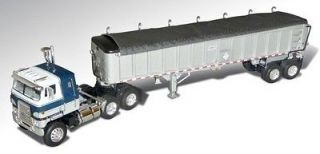DCP BLUE WHITE INTERNATIONAL CABOVER WITH SILVER EAST END DUMP TRAILER