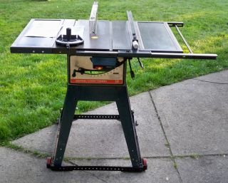 10 TABLE SAW 113.299040 CAST IRON. STAND WHEELS BLADES MANUALS INCHS