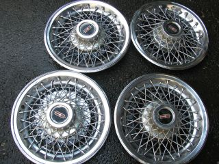 VINTAGE ORIGINAL EQUIPMENT WIRE RIM WHEEL COVERS 15 INCH OLDSMOBILE